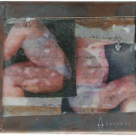 Copper frame on wood with photos and wax